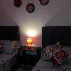 Отель Cheap Luxury Apart In Tangier With Wifi Марокко, Танжер - отзывы, цены и фото номеров - забронировать отель Cheap Luxury Apart In Tangier With Wifi онлайн комната для гостей фото 2