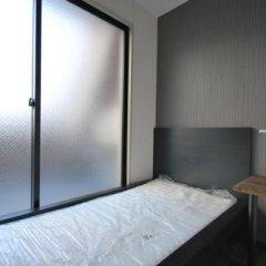 Отель Stay30 - Caters to Men Япония, Хаката - отзывы, цены и фото номеров - забронировать отель Stay30 - Caters to Men онлайн удобства в номере