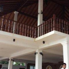 Отель Whispering Palms Hotel Шри-Ланка, Бентота - отзывы, цены и фото номеров - забронировать отель Whispering Palms Hotel онлайн парковка