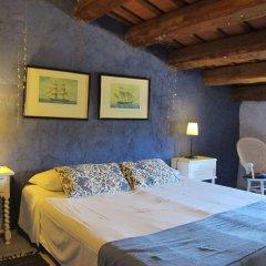 Отель Mas Can Puig de Fuirosos Сан-Селони комната для гостей