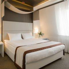 Гостиница УНО комната для гостей фото 2