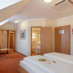 Отель Kriemhild am Hirschgarten Германия, Мюнхен - отзывы, цены и фото номеров - забронировать отель Kriemhild am Hirschgarten онлайн комната для гостей фото 2