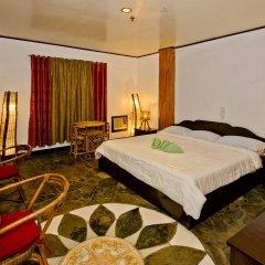 Отель La Chari'ca Inn Филиппины, Пуэрто-Принцеса - отзывы, цены и фото номеров - забронировать отель La Chari'ca Inn онлайн комната для гостей фото 2