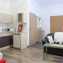 Апартаменты Queens Apartments Вена комната для гостей фото 3