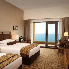 Отель Amwaj Rotana, Jumeirah Beach - Dubai комната для гостей