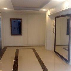 Отель Dlux Condominium Таиланд, Бухта Чалонг - отзывы, цены и фото номеров - забронировать отель Dlux Condominium онлайн интерьер отеля фото 2