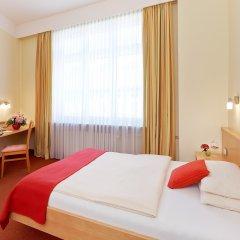 Отель Adria Munchen Мюнхен комната для гостей