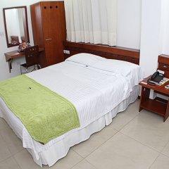 Отель Imbanaco Cali Колумбия, Кали - отзывы, цены и фото номеров - забронировать отель Imbanaco Cali онлайн комната для гостей