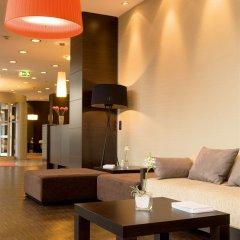 Отель NH Danube City Австрия, Вена - отзывы, цены и фото номеров - забронировать отель NH Danube City онлайн интерьер отеля фото 3
