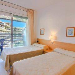 Отель Apartamentos S'Abanell Central Park Испания, Бланес - отзывы, цены и фото номеров - забронировать отель Apartamentos S'Abanell Central Park онлайн комната для гостей