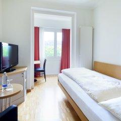 Отель Coronado Швейцария, Цюрих - 8 отзывов об отеле, цены и фото номеров - забронировать отель Coronado онлайн комната для гостей фото 4