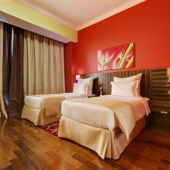 Abidos Hotel Apartment, Dubailand комната для гостей фото 2