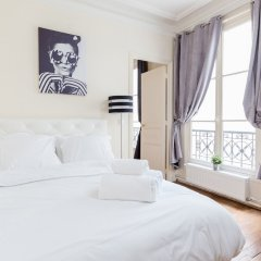 Апартаменты Arc de Triomphe Champs Elysees Apartment комната для гостей фото 5