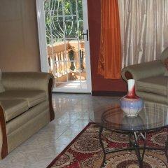 Апартаменты Cozy Apartments комната для гостей