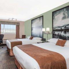 Отель Super 8 by Wyndham Saskatoon Near Saskatoon Airport комната для гостей фото 2