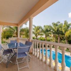 Отель Villas2Go2 Alvor Villa Португалия, Портимао - отзывы, цены и фото номеров - забронировать отель Villas2Go2 Alvor Villa онлайн балкон