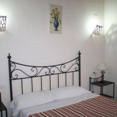Отель Abadia Suites комната для гостей