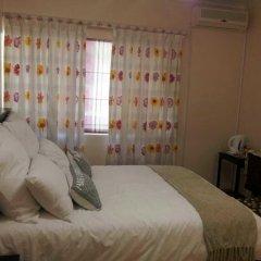Отель Hana Guest House Lodge Габороне комната для гостей