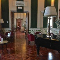 Отель Las Casas de la Juderia Sevilla Испания, Севилья - отзывы, цены и фото номеров - забронировать отель Las Casas de la Juderia Sevilla онлайн гостиничный бар