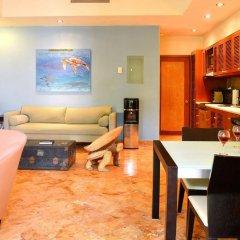 Отель Porto Playa Condo Hotel & Beachclub Мексика, Плая-дель-Кармен - отзывы, цены и фото номеров - забронировать отель Porto Playa Condo Hotel & Beachclub онлайн интерьер отеля