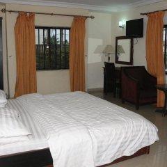 Отель Michelle Suites Нигерия, Калабар - отзывы, цены и фото номеров - забронировать отель Michelle Suites онлайн комната для гостей фото 5