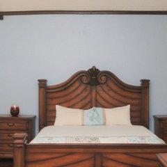 Отель The Oasis at Marley Manor Ямайка, Кингстон - отзывы, цены и фото номеров - забронировать отель The Oasis at Marley Manor онлайн сейф в номере