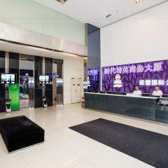 Отель Nomo Times International YOU Apartment Китай, Гуанчжоу - отзывы, цены и фото номеров - забронировать отель Nomo Times International YOU Apartment онлайн интерьер отеля