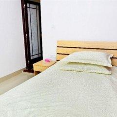 Апартаменты Jiujiu Express Apartment Сямынь комната для гостей фото 3