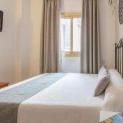 Отель Hostal Dinamarca Испания, Сан-Антони-де-Портмань - отзывы, цены и фото номеров - забронировать отель Hostal Dinamarca онлайн комната для гостей фото 5