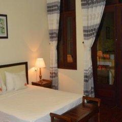 Отель Orchids Homestay сейф в номере