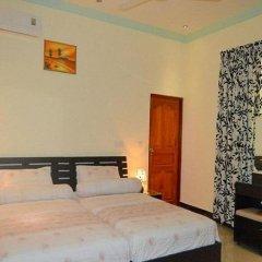 Отель Charming Holiday Lodge Мальдивы, Хулхудху (Атолл Адду) - отзывы, цены и фото номеров - забронировать отель Charming Holiday Lodge онлайн Хулхудху (Атолл Адду) комната для гостей фото 4
