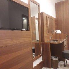 Отель Leisure Inn удобства в номере