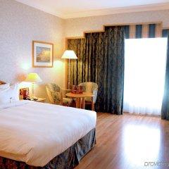Отель Crowne Plaza Abu Dhabi комната для гостей фото 5