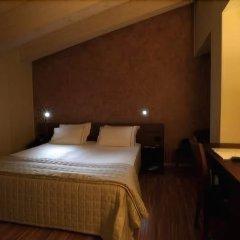 Отель EKK Hotel Италия, Ситта-Сант-Анджело - отзывы, цены и фото номеров - забронировать отель EKK Hotel онлайн комната для гостей фото 2