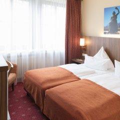 Отель Schlicker Германия, Мюнхен - отзывы, цены и фото номеров - забронировать отель Schlicker онлайн комната для гостей фото 4