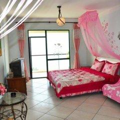 Апартаменты Sanya Haizhixing Seascape Holiday Apartment комната для гостей фото 3