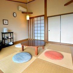 Отель Spa Greenness Минамиогуни комната для гостей фото 2
