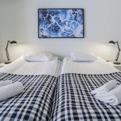 Апартаменты Kotimaailma Apartments Albertinkatu 27B комната для гостей