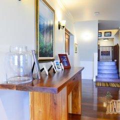 Отель Tallawah Villa, Silver Sands Jamaica 7BR в номере