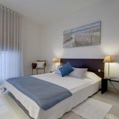 Отель Marvellous Apartment in Tigne Point With Pool Мальта, Слима - отзывы, цены и фото номеров - забронировать отель Marvellous Apartment in Tigne Point With Pool онлайн комната для гостей фото 5