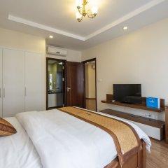 Апартаменты Bayhomes Times City Serviced Apartment комната для гостей