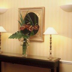 Отель Golden Tulip Washington Opera Франция, Париж - 11 отзывов об отеле, цены и фото номеров - забронировать отель Golden Tulip Washington Opera онлайн удобства в номере фото 2
