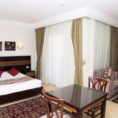 Апартаменты Pyramisa Sunset Pearl Apartments комната для гостей фото 3