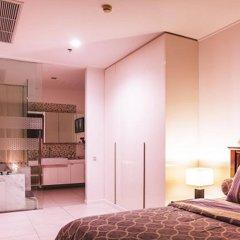 Апартаменты Luxury Apartments NorthPoint Pattaya by GrandisVillas Паттайя комната для гостей фото 4