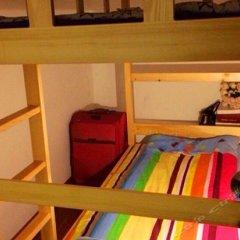 Tianjin Jinhai Post International Youth Hostel комната для гостей