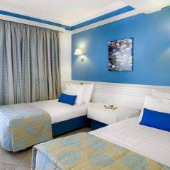 Отель Aldemar Amilia Mare - All Inclusive комната для гостей