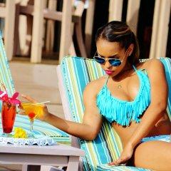 Отель Beachcombers Hotel Сент-Винсент и Гренадины, Остров Бекия - отзывы, цены и фото номеров - забронировать отель Beachcombers Hotel онлайн детские мероприятия