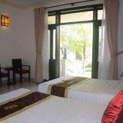 Отель Hoi An Red Frangipani Villa комната для гостей фото 4
