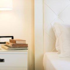 Отель I Monasteri Golf Resort Сиракуза сейф в номере
