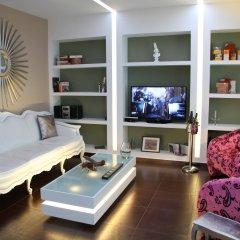 Отель Andromeda Suites and Apartments Греция, Афины - отзывы, цены и фото номеров - забронировать отель Andromeda Suites and Apartments онлайн комната для гостей